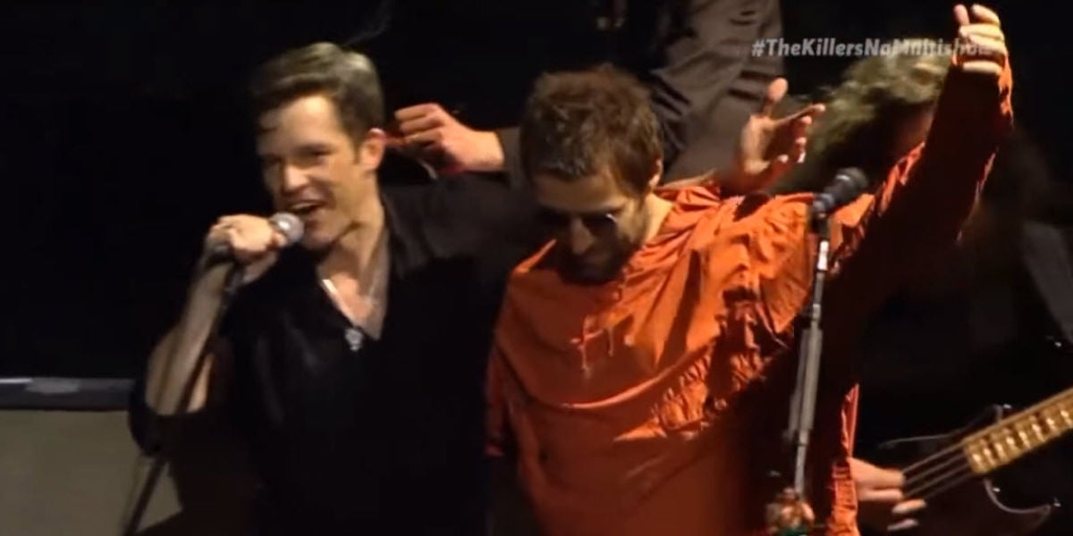 Brandon Flowers y Liam Gallagher en un concierto de The Killers