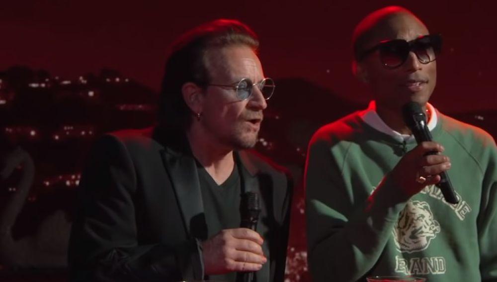 Bono y Pharrel Williams