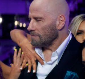 John Travolta en el videoclip '3 to Tango' de Pitbull