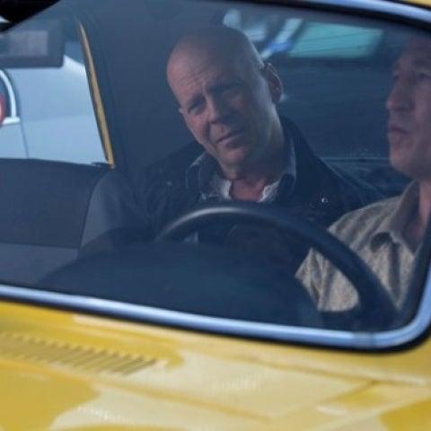 Bruce Willis en un taxi