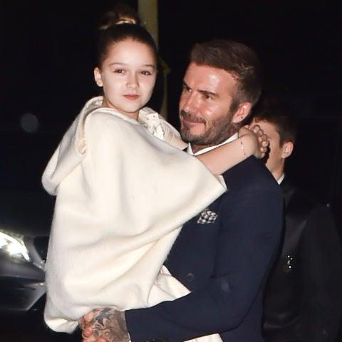 David Beckham con su hija Harper en brazos